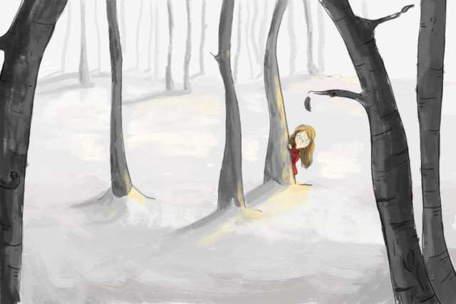 little girl in the woods peeking from behind a tree